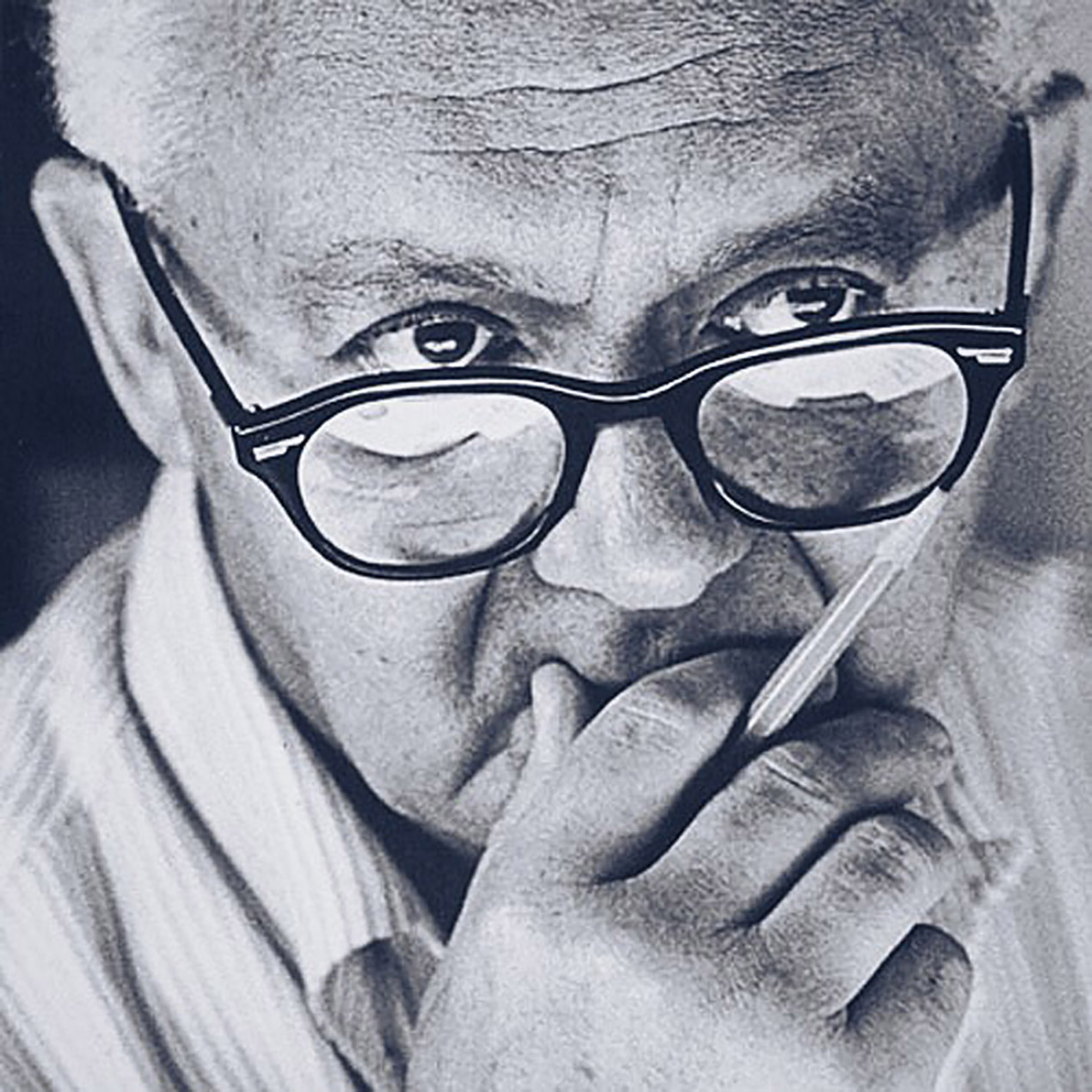old man wearing glasses lost in thought