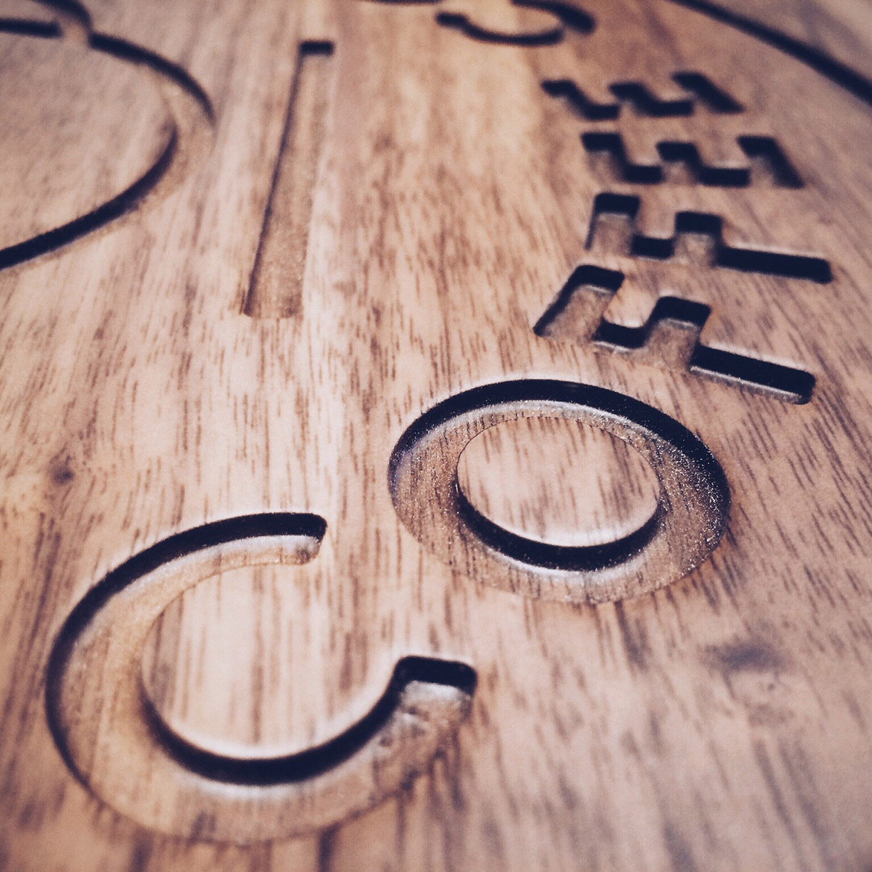 the letters coffee carved in to wooden table