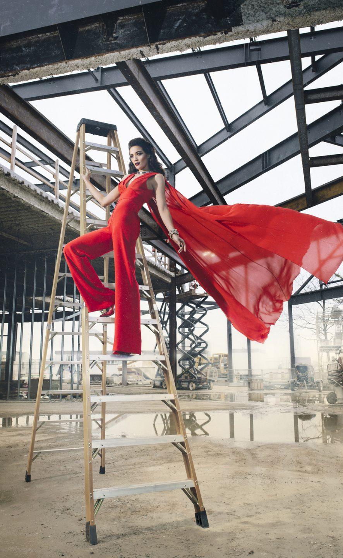Jadde Tenholder on ladder in red dress