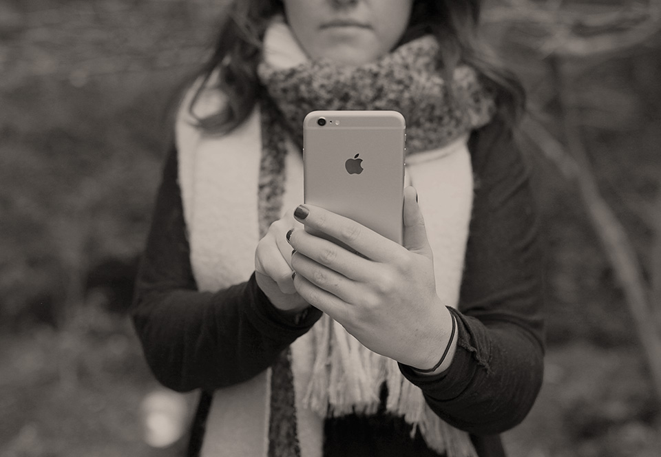person using iphone for Marketing Communications