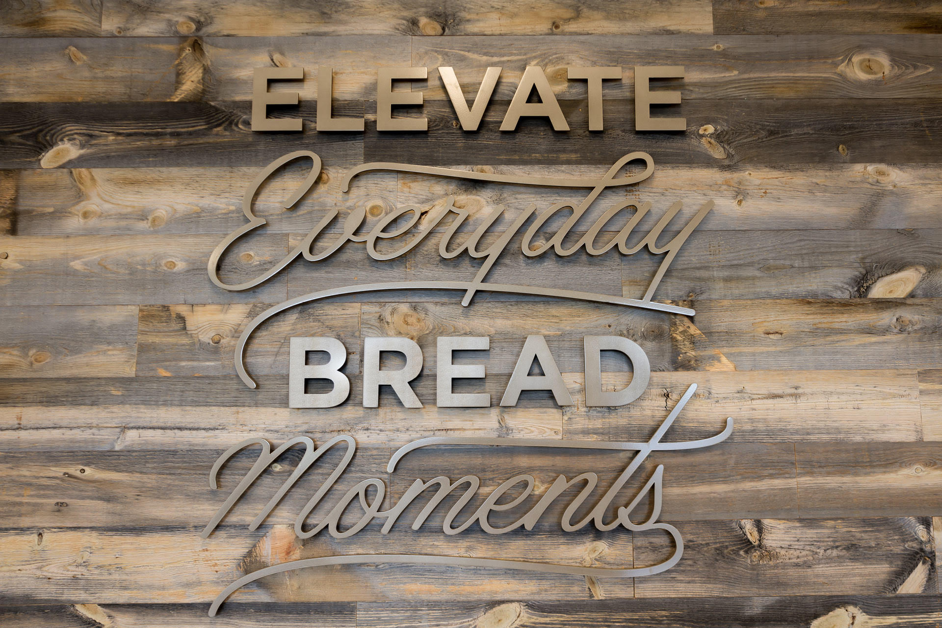 elevate everyday bread moments sign
