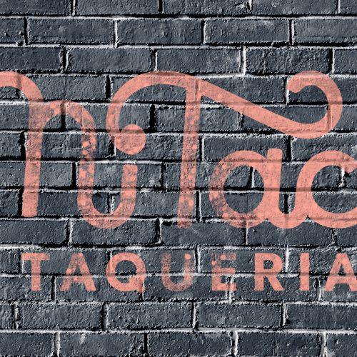 Mi Taco Brick logo